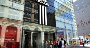 NEW YORK, NY - JULY 31:  An Adidas store is viewed in Manhattan on July 31, 2014 in New York City.  The German sporting goods manufacture surprised investors with a profit warning on Thursday that lowered its shares by as much as 16%. Blaming currency issues, lower consumer spending in Russia, poor golf-equipment sales and other issues, Adidas said second-quarter net profit fell 16% from the year-earlier.  (Photo by Spencer Platt/Getty Images)